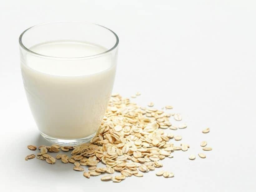 a glass of oat milk